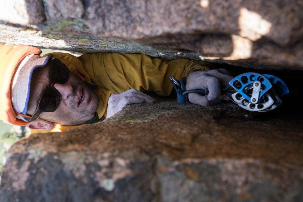 Thad climbing an offwidth on the Curecanti Needle.