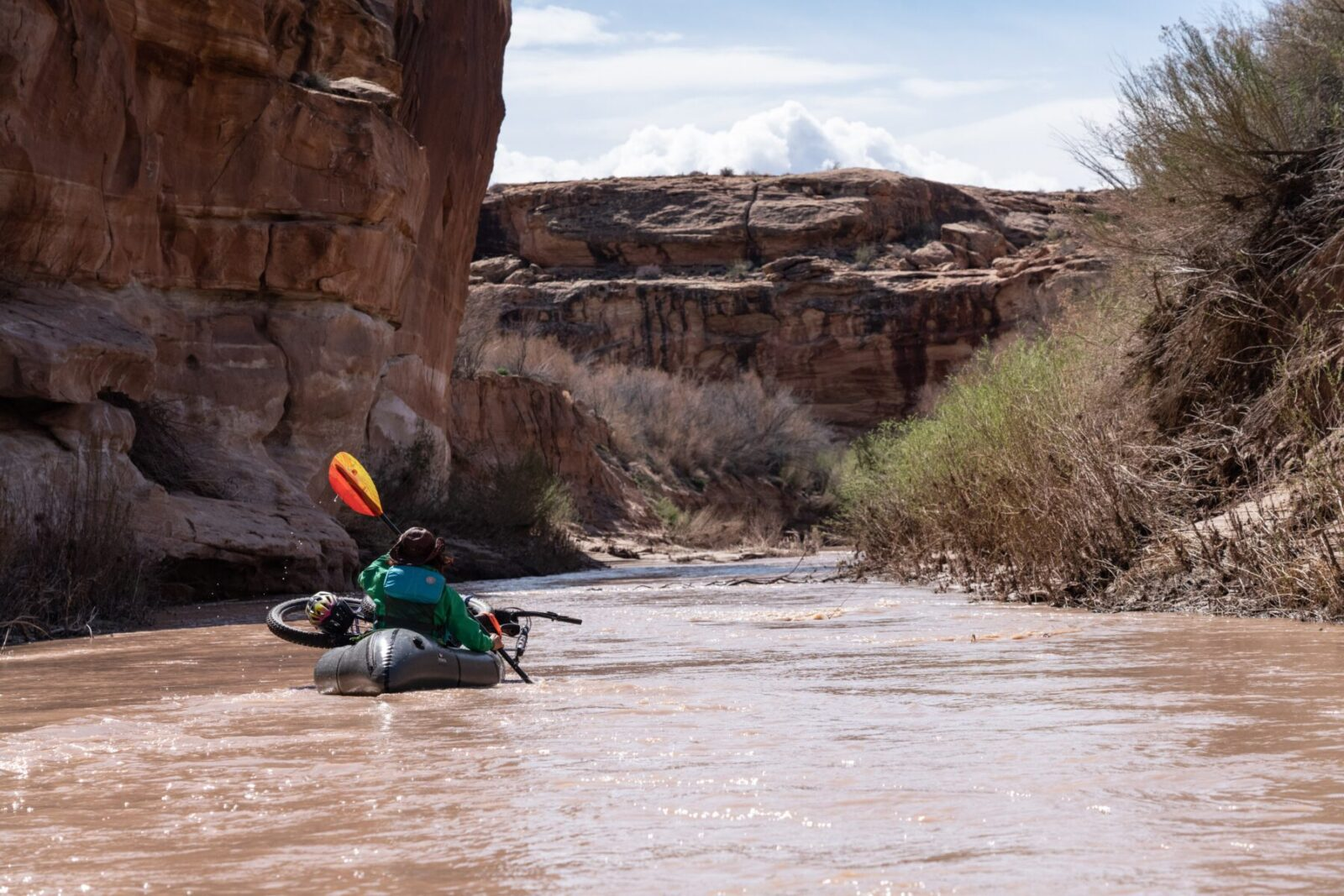 Lizzy Scully bikerafting in Southern Utah.