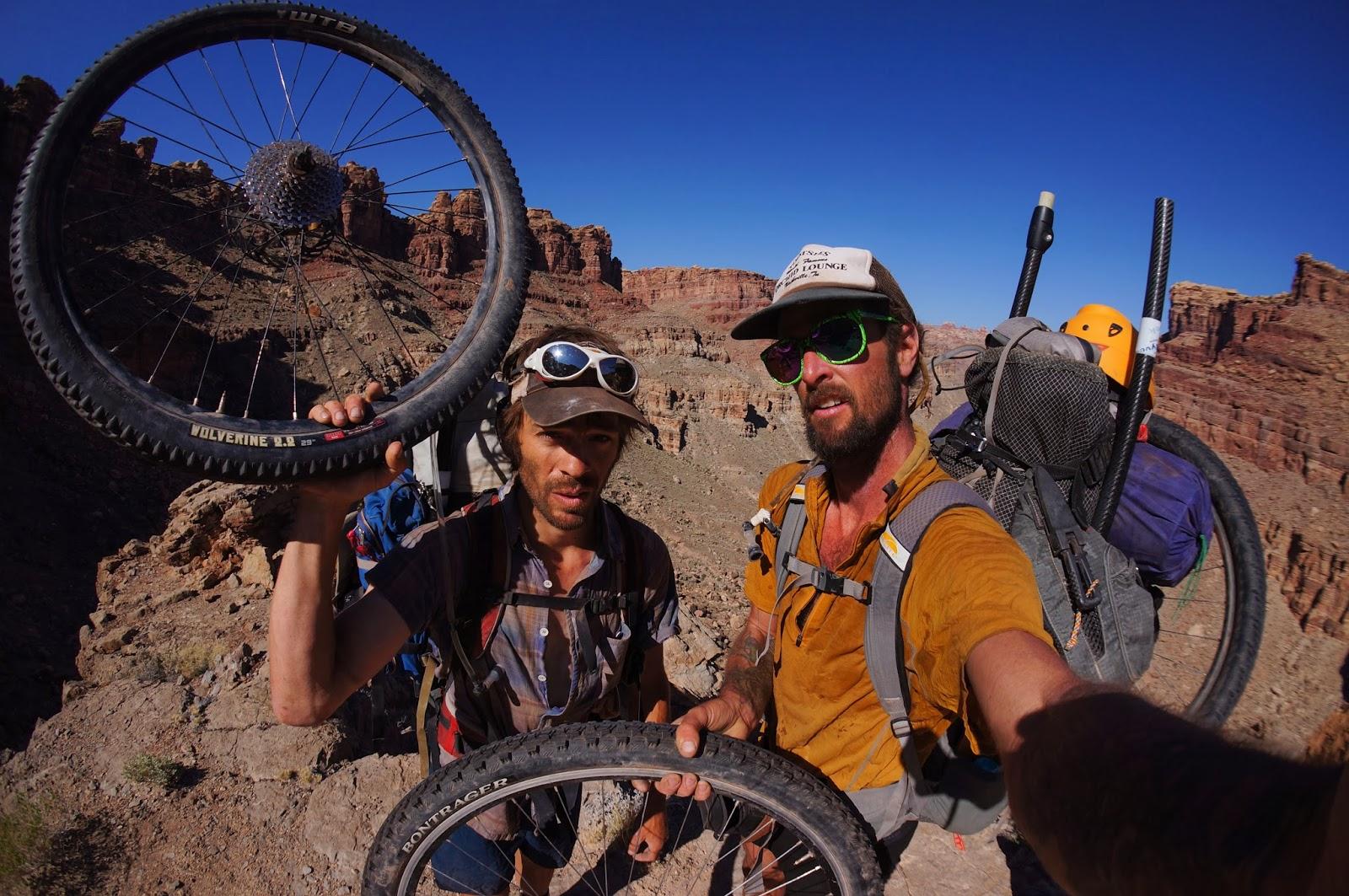 Thad Ferrell and Steve Fassbinder bikeraft desert Utah.