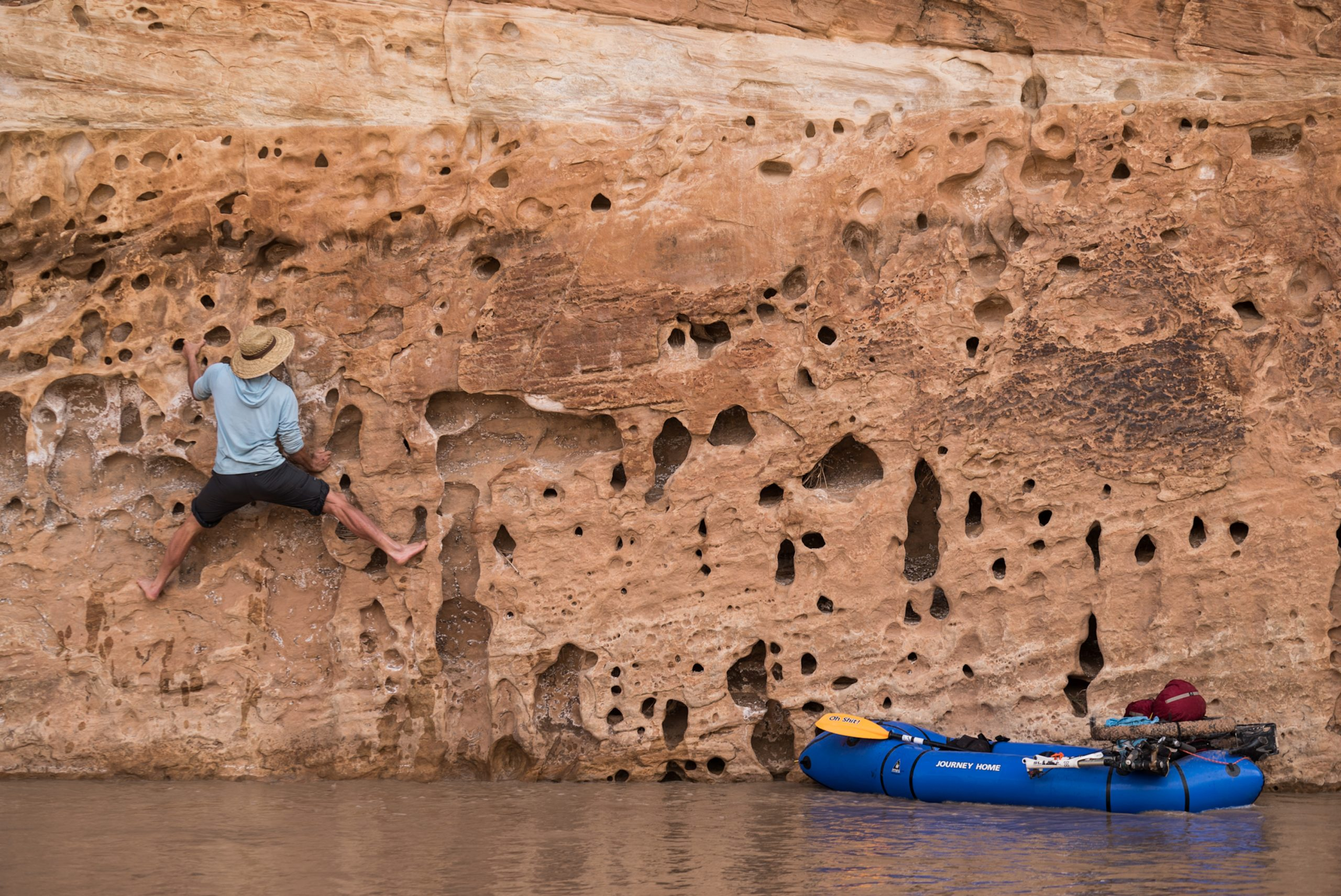 Andrew Burr barefoot bouldering over the Dirty Devil Southern Utah